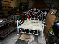 A forged double bed frame..